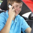 Teenage Boy Sitting In Car, Talking On Cellphone — Stock Photo