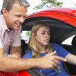 Teenage Girl Learning How To Drive - Stock Photo