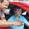 Foto de Stock  : Teenage Boy Learning How To Drive