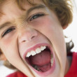 Stock Photo: Portrait Of Boy Shouting