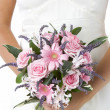 Stock Photo: Bride Holding Bouquet Of Flowers