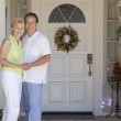 Couple Standing Outside Their House — Stock Photo