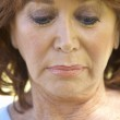 Portrait Of Middle Aged Woman Looking Down — Stock Photo