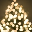 Abstract view of christmas tree and lights - 图库照片