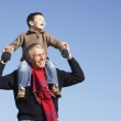 Grandfather Carrying Grandson On His Shoulders — Stock Photo #4788637