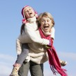 Grandmother Giving Her Granddaughter A Piggy Back Ride — Stock Photo #4788649