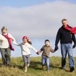Grandparents And Grandchildren Running In The Park — Stock Photo #4788652