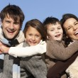 Parents Piggy Backing Their Children — Stock Photo