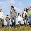Family Walking In The Park — Stock Photo #4788705