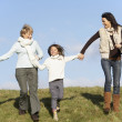 Grandmother And Mother Holding Hands With Young Girl — Stock Photo #4788709