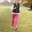 Stock Photo: Senior Woman Power Walking In The Park