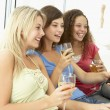 Stock Photo: Female Friends Watching Television Together