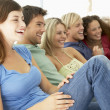 Stock Photo: Friends Watching Television Together