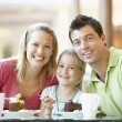 Royalty-Free Stock Photo: Family Having Lunch Together At The Mall