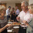 Woman Serving Hors D'oeuvres To Her Guests At A Dinner Party — Stock Photo