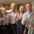 Friends Enjoying A Glass Of Champagne At A Dinner Party — Stockfoto