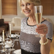Stock Photo: Woman Throwing A Dinner Party