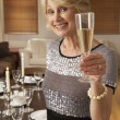 Woman Throwing A Dinner Party - Stock Photo