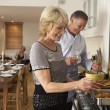 Stockfoto: Couple Preparing Food For A Dinner Party