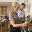 Foto de Stock  : Couple Preparing Food For A Dinner Party