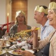 Friends Wearing Party Hats At A Dinner Party — Lizenzfreies Foto