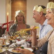 Friends Wearing Party Hats At A Dinner Party — Stok fotoğraf