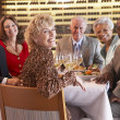 Friends Having Dinner Together At A Restaurant — Stock Photo