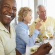 Friends Having Lunch Together At A Restaurant - Foto Stock