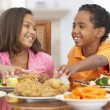 Brother And Sister Having Lunch Together At Home - Stock Photo