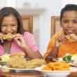 Stock Photo: Brother And Sister Having Lunch Together At Home
