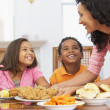 Mother Serving A Meal To Her Children At Home — Stock Photo #4789187