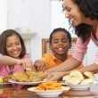 Stock Photo: Mother Serving Meal To Her Children At Home