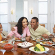 Family Having A Meal Together At Home - Stock Photo