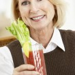 Woman Drinking A Bloody Mary - Stock Photo