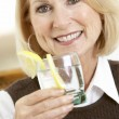 Стоковое фото: Woman Having A Drink At Home