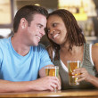 Stock Photo: Couple Drinking Beer Together In Pub
