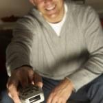 Man Using Television Remote Control — Stock Photo