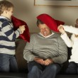 Father And Two Children In Pillow Fight - Stock Photo