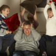 Parents And Two Children In Pillow Fight — Stock Photo
