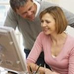 Couple Using Computer — Stock Photo