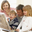 Family Group Using Computer - Stock Photo