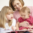 Mother And Daughters Reading Book — Stock Photo