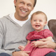 Father And Baby Daughter On Sofa — Stock Photo
