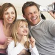 Stock Photo: Parents And Daughter With Video Camera