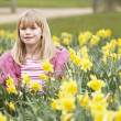 Young Girl Surrounded By Daffodils — Stock Photo