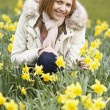 Woman Kneeling In Daffodils — Stock Photo