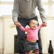 Father Helps Baby Daughter With Walking — Stock Photo #4789537