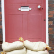 Sandbags Stacked In A Doorway In Preparation For Flooding — Stock Photo #4789620