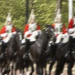 Household Cavalry Riding In The Street - Stock Photo