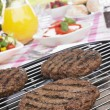 Burgers Cooking On Barbeque Grill - Stockfoto